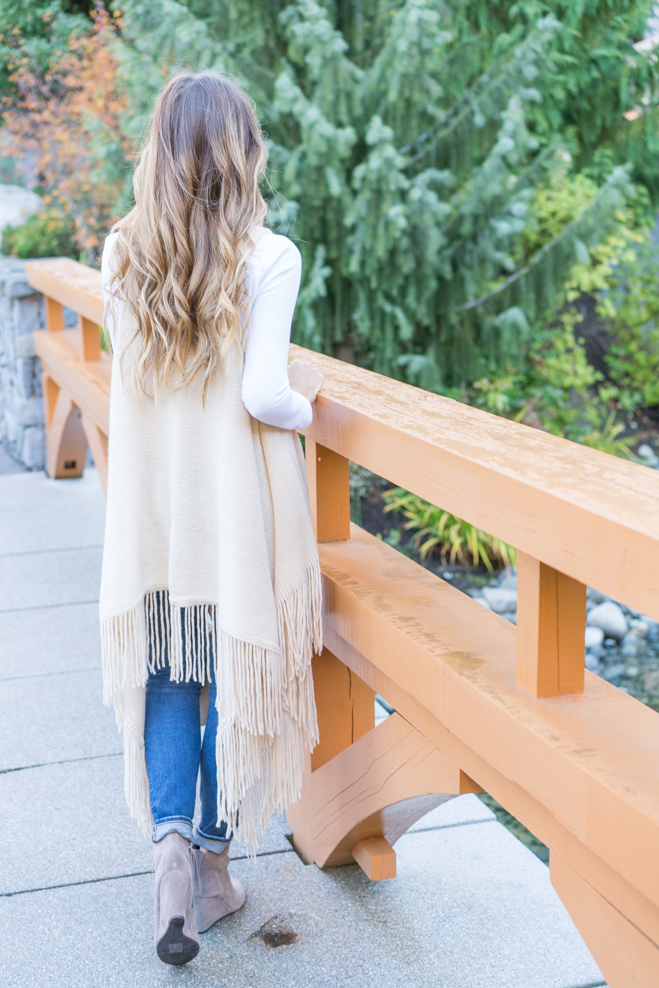 Nordstrom Fall outfit fringe sweater vest white thermal tee distressed ag skinny jeans dolce vita tan booties angela lanter hello gorgeous